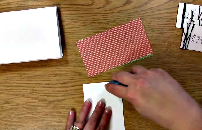 apply adhesive to the back of the patterned paper