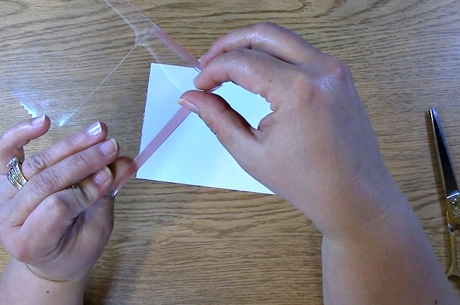 place strong adhesive on the edges used to close the envelope