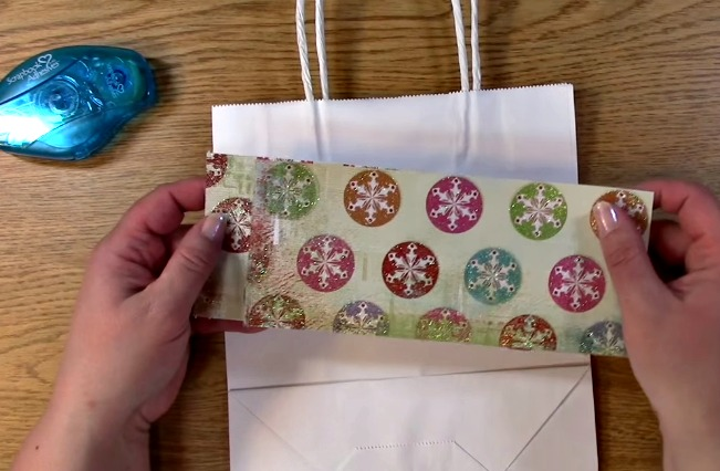 measure two pieces of paper to fit on the front of bag
